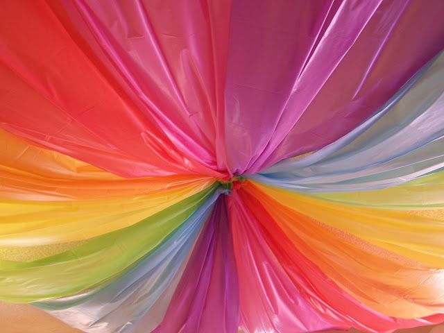 Use Plastic Table Cloths For Ceiling And Balloons To Middle