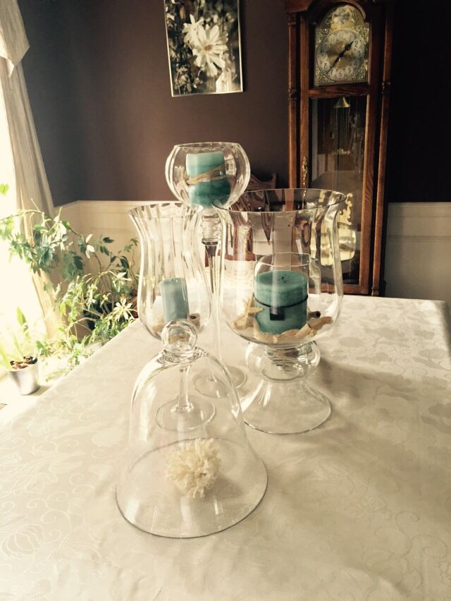 Aqua blue candles and sea shell centerpiece