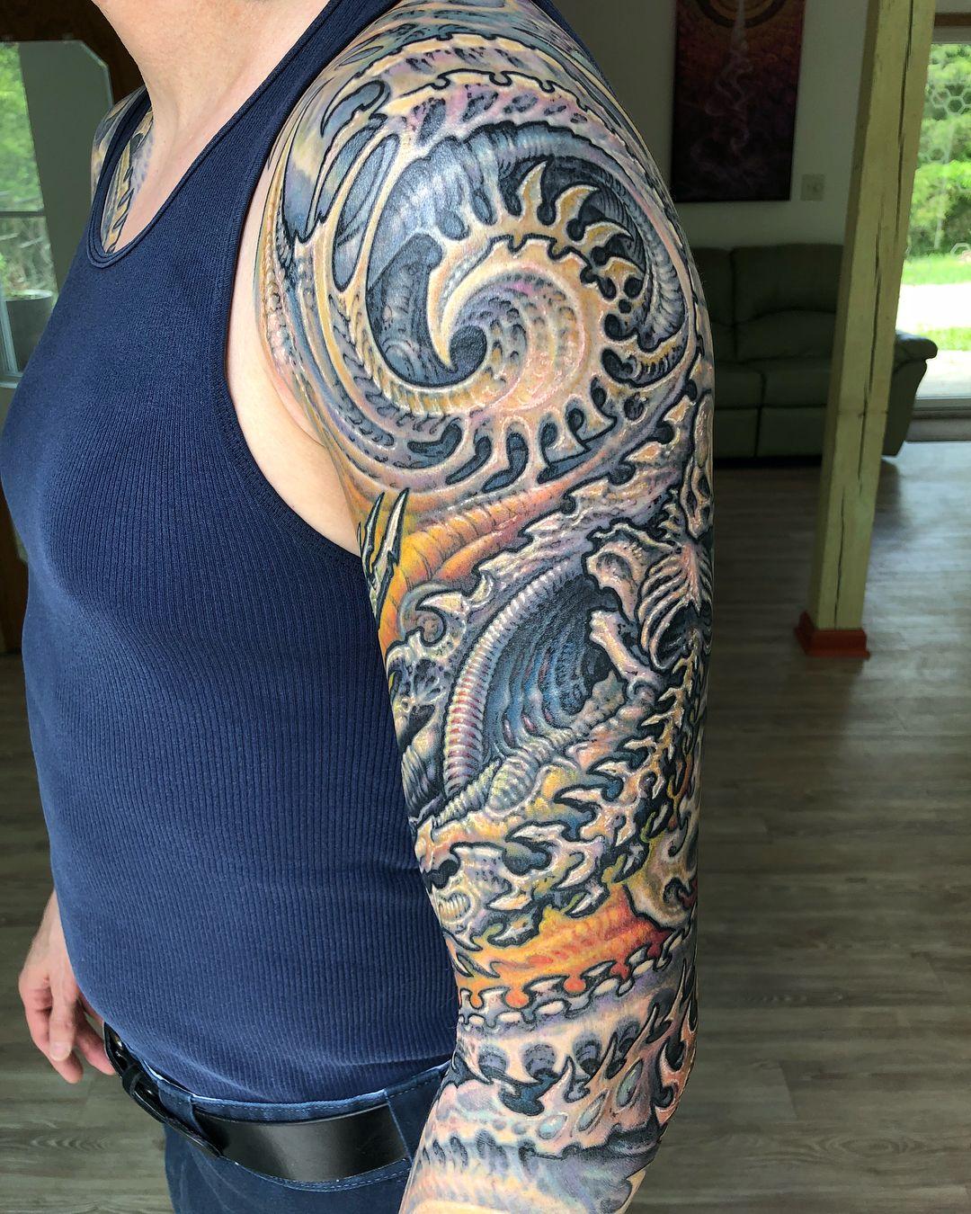 Biomechanical tattoo Guy Aitchison Half sleeve tattoos