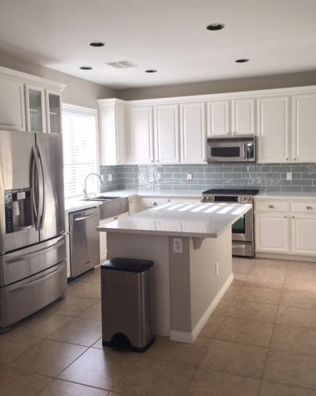 """""""We are so happy and thrilled. We love our kitchen, and it really has opened up our house. It's so inviting -- we love to entertain now! Sometimes I even catch my husband just standing there staring at our kitchen with a big smile on his face."""""""