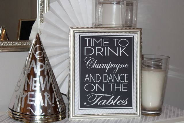 Decor at a Silver and White New Year's Eve Party #silver #newyears