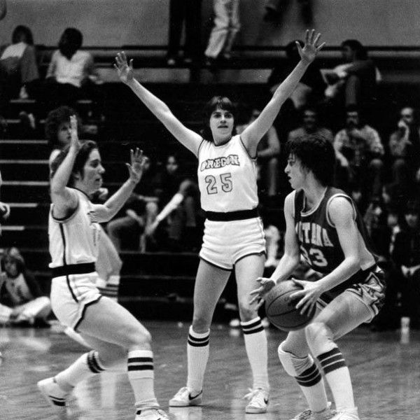 University of Oregon basketball players Allison Towriss (left) and Julie Cushing (#25) playing defense against Montana in the second game of the Association for Intercollegiate Athletics for Women tournament at McArthur Court on March 7, 1980 and won by the Ducks 77-41. ©University of Oregon Libraries - Special Collections and University Archives