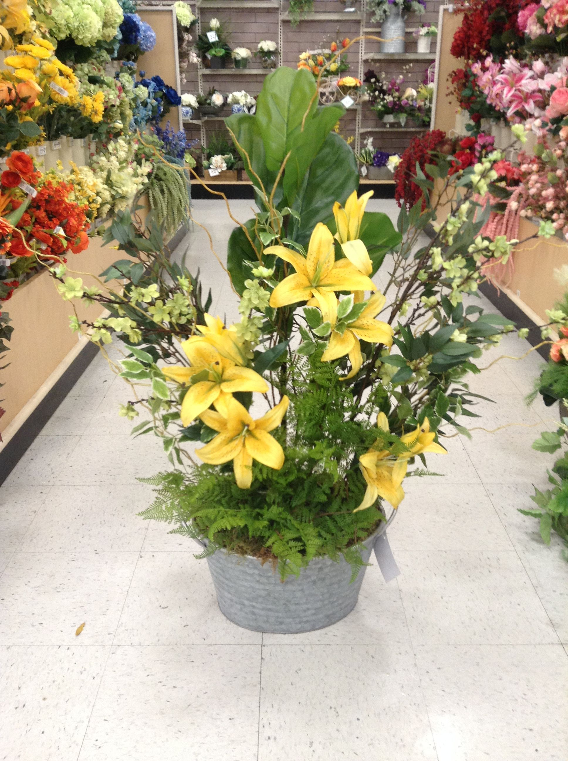 Big Floral Arrangement Of Yellow Lilies And Greenery In Galvanized Bucket Yellow Lily Floral Arrangements Arrangement
