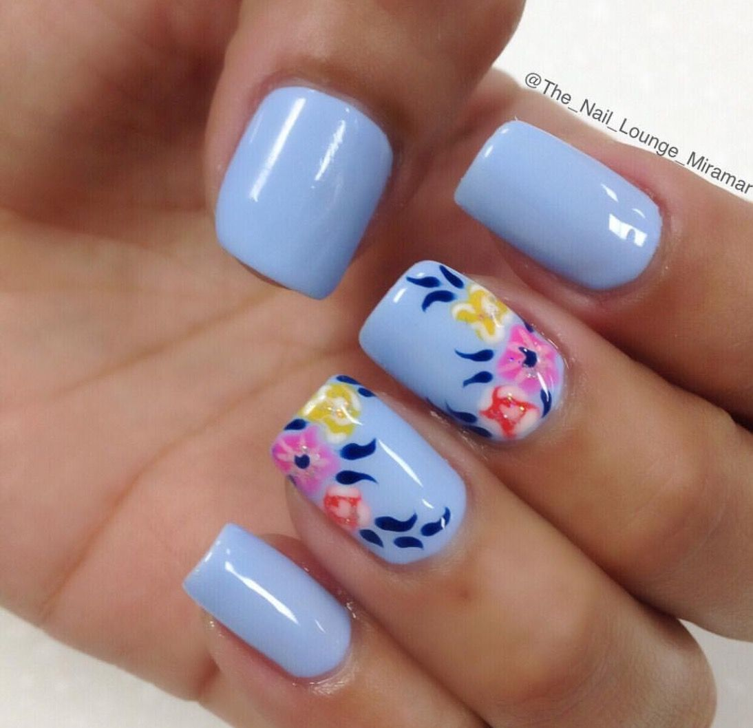 Pin by jauquese knowles on nailed it pinterest beauty nails a very pretty blue floral nail art design the base color used is baby blue while on top colorful flowers are painted over with dark blue leaves prinsesfo Images