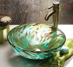 Aqua Iris by Suzanne Guttman. A luminous piece of fine glass art, doubling as a glass sink. An elegant statement of lasting value. Each sink is formed by hand and signed by the artist. Designed to be set on the counter top. Height will range from 6