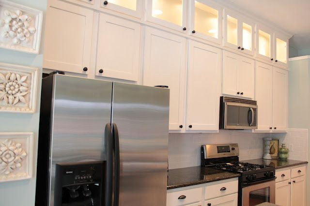 remodeled kitchen... love how she used the space above the original cabinets as display cabinets
