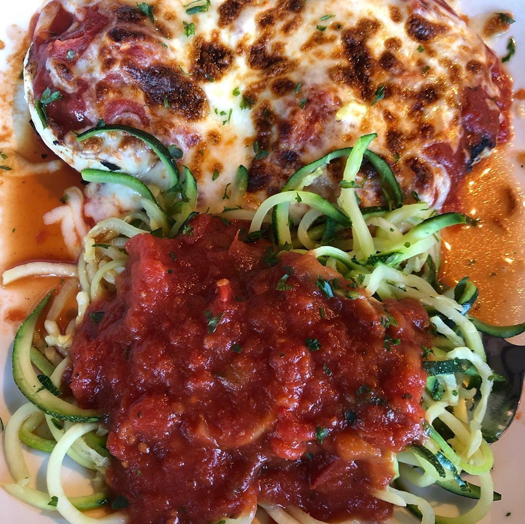 Eating right at Olive Garden!  In addition to a side salad, I ordered grilled chicken Parmesan and s...