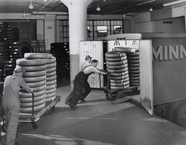 Loading Tires for Shipment | Photograph | Wisconsin Historical Society