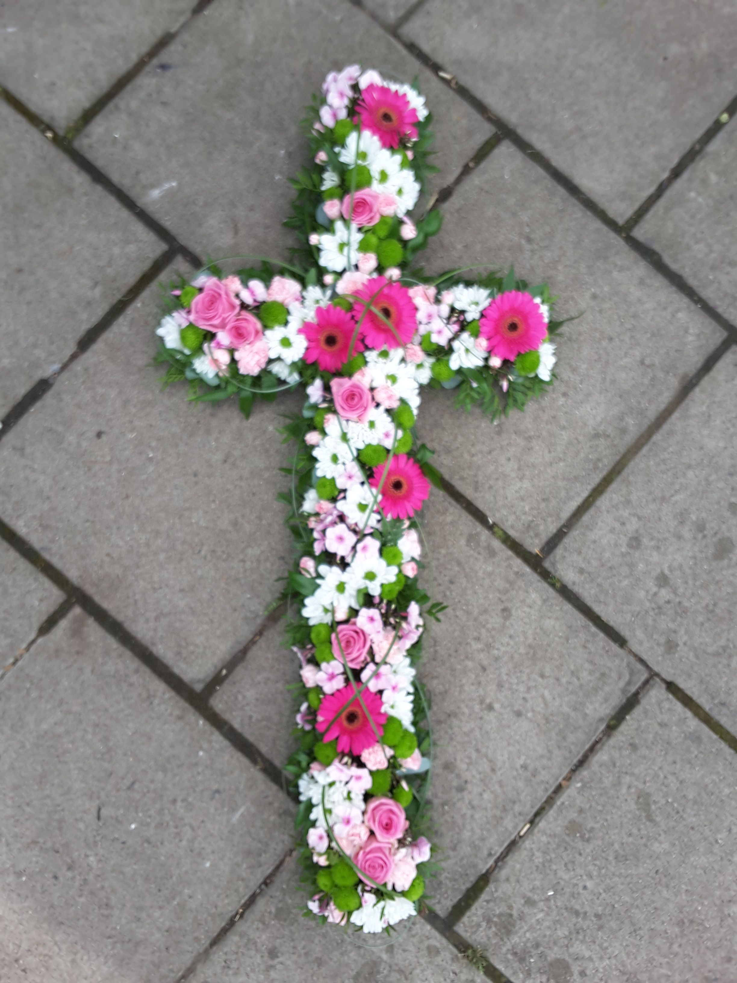 Pink and white loose based funeral Cross with Bear grass