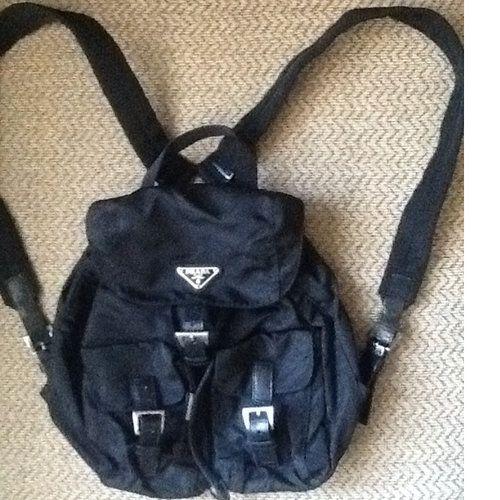 423d99f2a6e3 AUTH PRADA Black Nylon Small Backpack Handbag Serial No. 104, on inside zip  pocket Hardware: Silver Tone Closure: Magnetic Popper/Buckle Print: Solid  ...