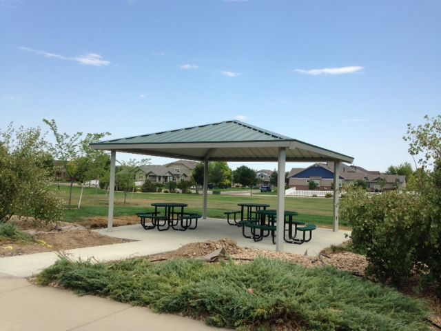 Go Play S Superior Hip Roof All Metal Shelter With Round Picnic Tables Round Picnic Table Hip Roof Picnic Table