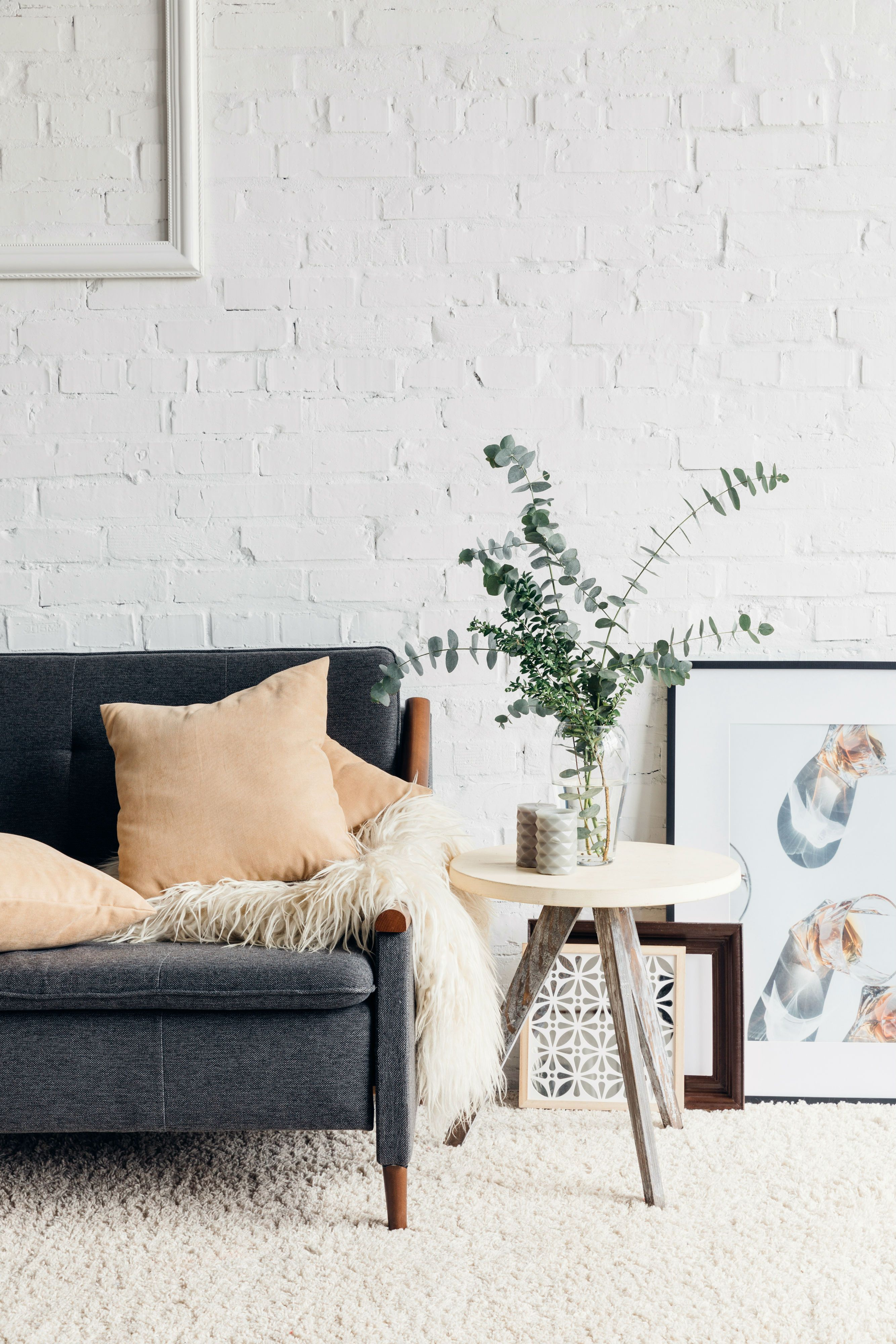 A Contemporary Living Room With A Beautiful White Brick Wall