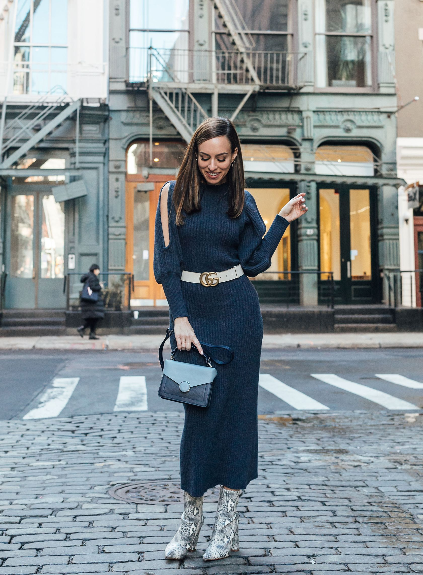 d5202e7ce306c Sydne Style shows new york fashion week street style trends in gucci belt sweater  dress and snakskin booties #sweaterdress #fashionweek #streetstyle ...