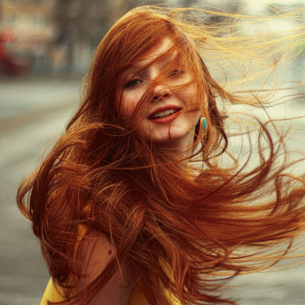 lots of red hair blowing in
