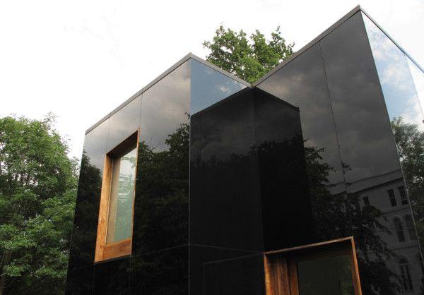 Striking Black Glass Home Mirrors Its Rich Surroundings Design Milk Glass Facades Glass Building Mirror House
