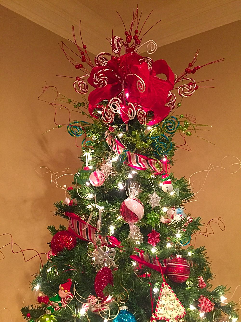 My tree topper made from hobby lobby ribbon and picks