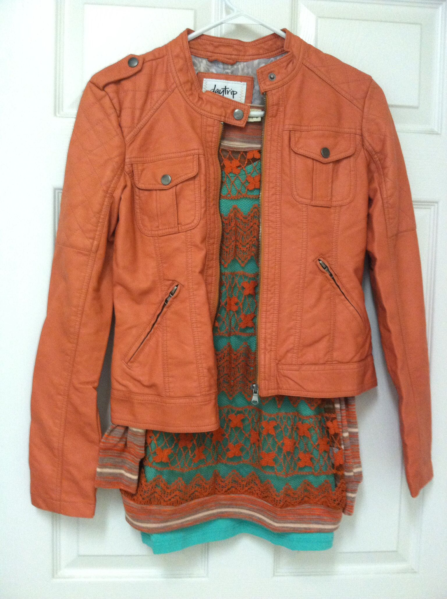 Coral jacket, lace tee and green tank