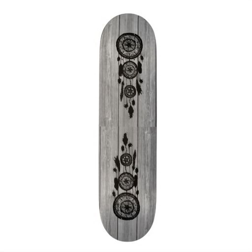 Hipster vintage black dreamcatcher on gray wood custom skateboard