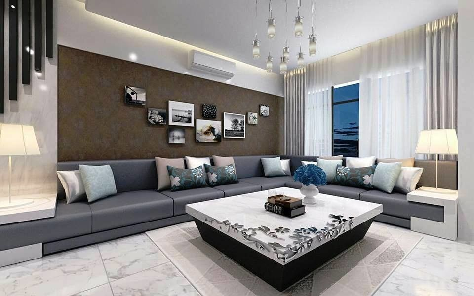 View of living room space with corner sofa having in built ...