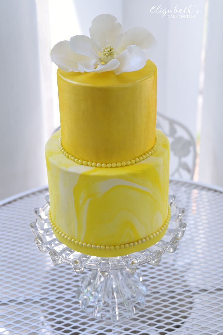 Sweet yellow marble wedding cake made with fondant and a white ...