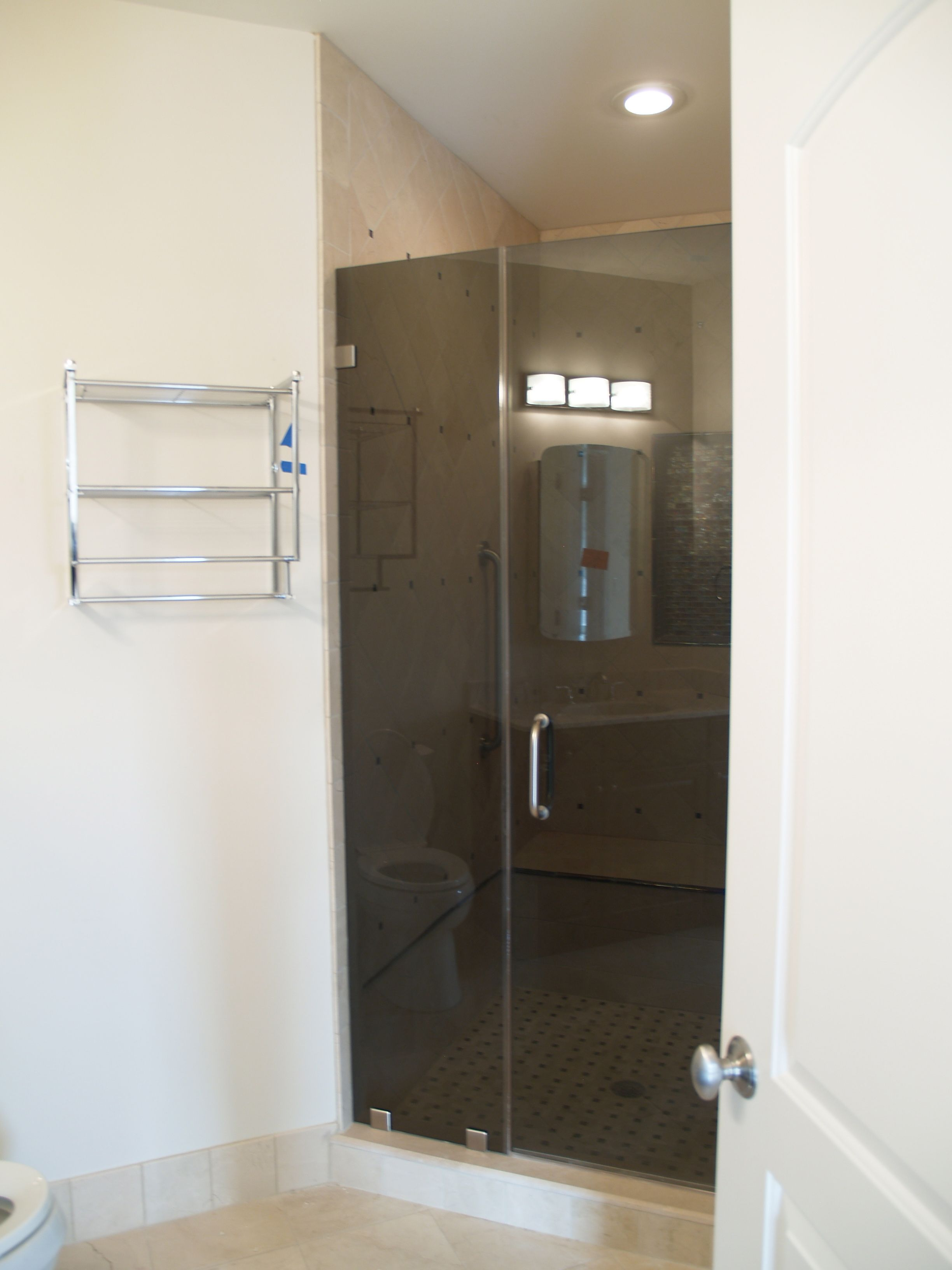 Frameless shower door in 3 8 thick tinted tempered glass for Master bathroom glass doors