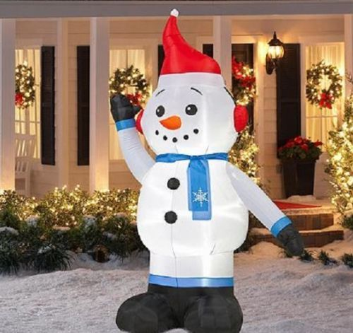 7-Foot-Inflatable-Snowman-Earmuffs-Outdoor-Lighted-Christmas-Yard - inflatable christmas yard decorations