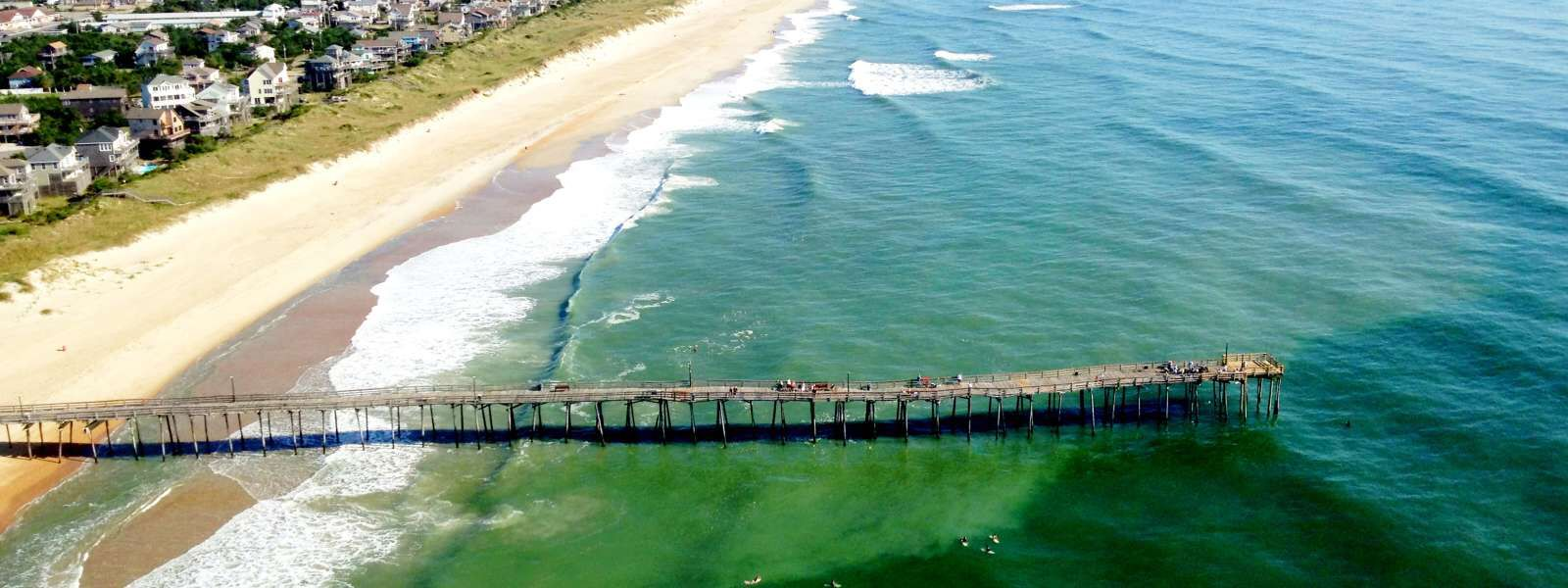 Surfs up Fall/Winter Season - Surf the Outer Banks in North Carolina! Low Cost Flights to Norfolk International Airport &Raleigh Durham International! Grab your Surfboard & Book your Flights @ www.FirstClassTravelNow.com #FirstClassTravelNow #OuterBanksNC #SurfTheOuterBanks #Fly2NorthCarolina #LowCostAirfare #CheapFlights #SurfIsUp