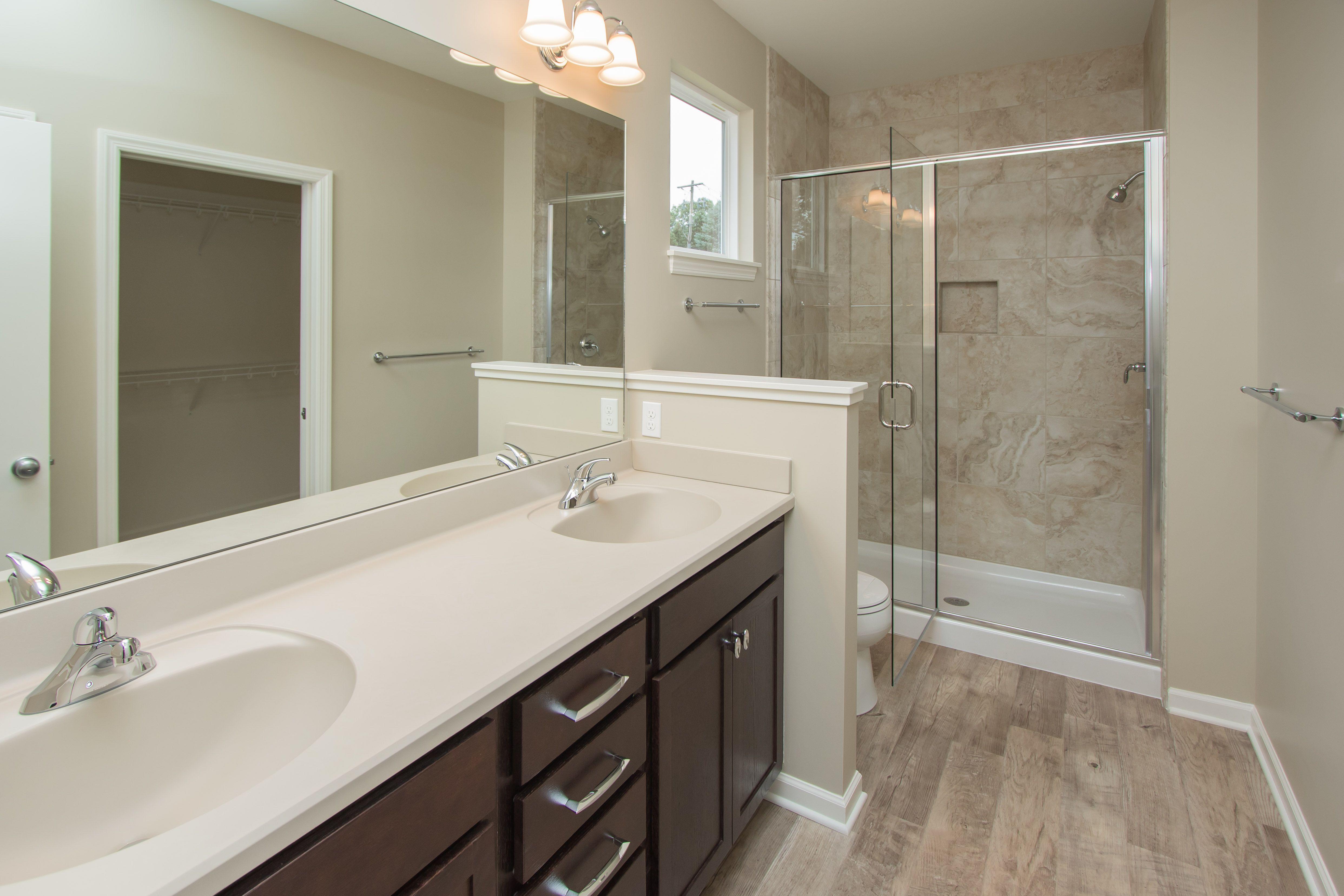 Master bathroom features luxury vinyl tile (LVT) floors