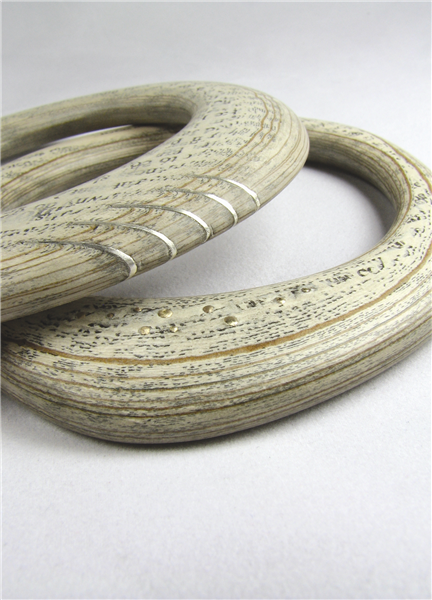 bangles - Leah Miles  is a paper artist who uses an innovative hand-making process that transforms recycled paper into wearable pieces