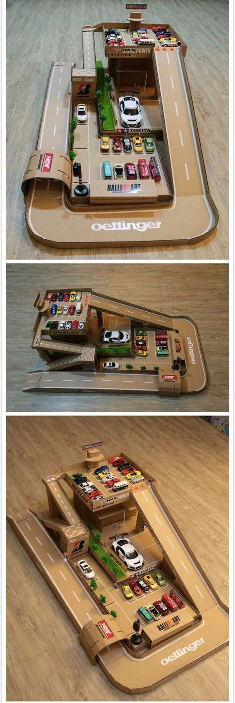 Ein selbstgebasteltes Parkhaus aus Karton. Ein Traum Spielzeug für fahrbegeisterte Mädchen und Jungen.