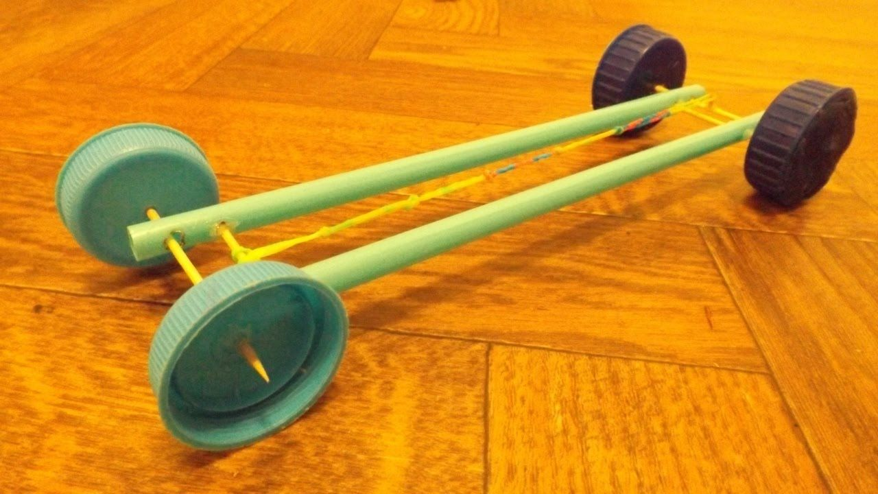 How to make a rubber band car out of four straws