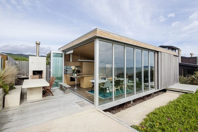 The top part of the house opens up to the view ARCHITECTURE