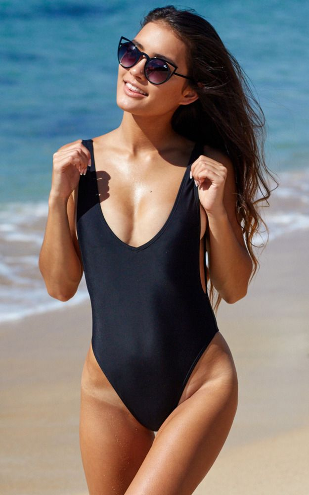 2cc9d9a4c8 This stylish black one piece swim suit features a plunging open back and  armhole to reveal a bit of side boob and a high cut hip to show off those  hip bones
