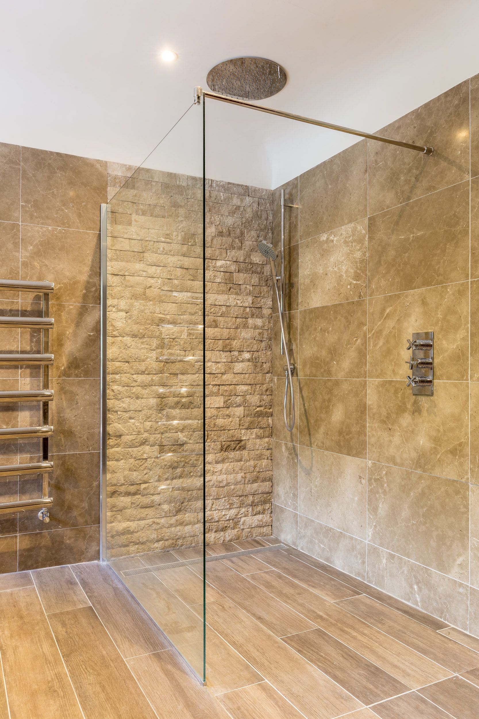 contemporary bathroom  feature stone wall tiles  texture  rainmaker  glass screen  gulley