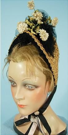 c1885 Straw bonnet with black lace & silk flowers with double ties.  For more images: http://www.antiquedress.com/item6385.htm