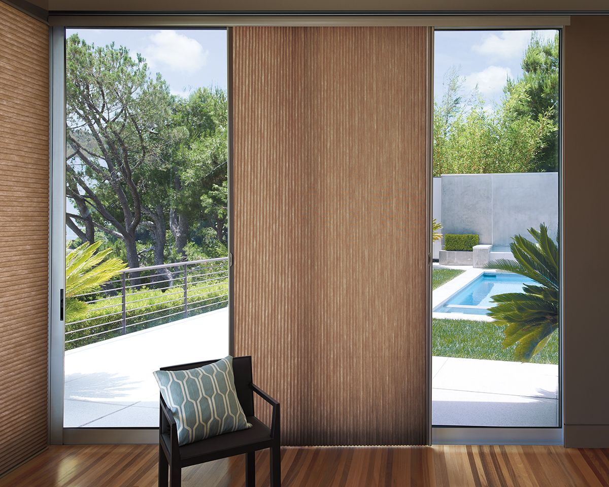 Hunter douglas applause vertiglide honeycomb shades are a perfect transition from the indoors to the outdoors a most versatile window treatment that