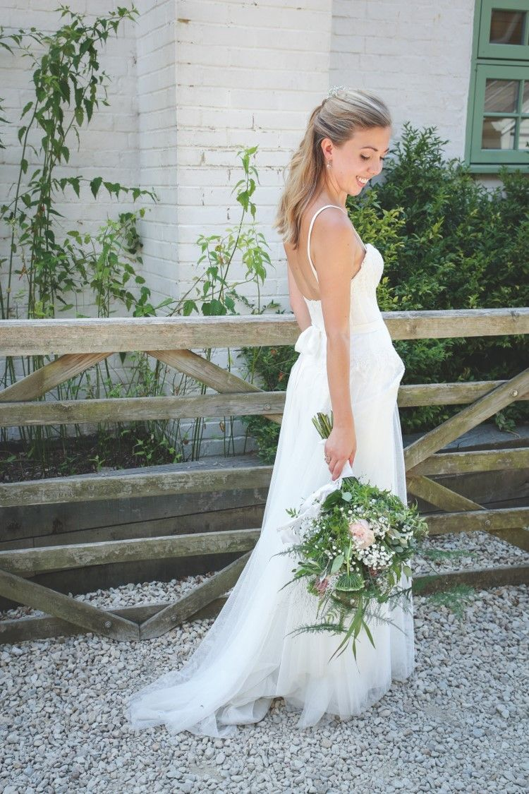 6adb4d4bd45f Bride Lucy wears the Lupine gown by Willowby for her Gate Street Barn  wedding in Bramley. Dress supplied via Bridal Indulgence, a Hampshire  wedding ...