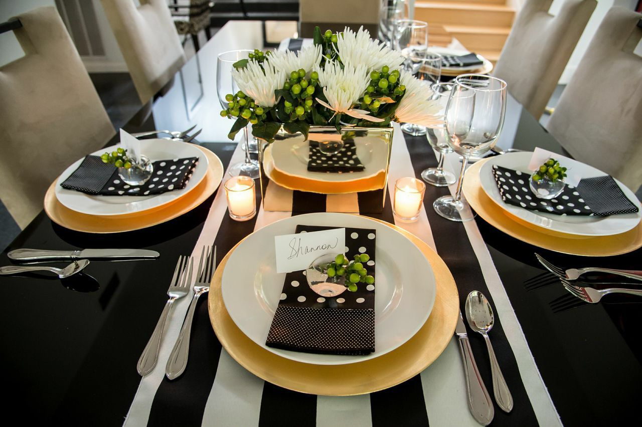 Kate spade inspired tablescape featuring a black and white stripe blossom place card holders gold charger plates and gold vase 10900 httpssparkleanddineproductkate spade inspired glam table styling kit reviewsmspy