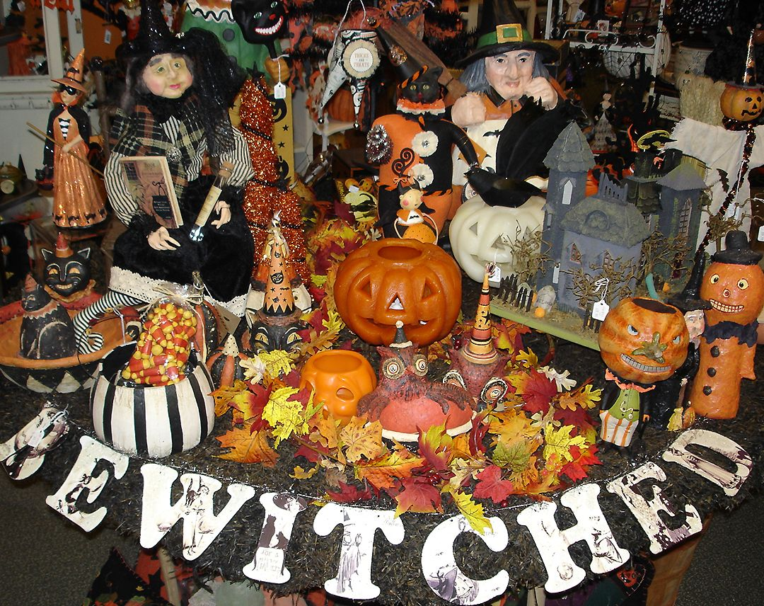 Witches, Pumpkins and Haunted houses decorate our round main table - halloween houses decorated