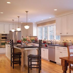 Large open kitchen. Wall oven + regular over, farmhouse sink - love the bar and eat-in kitchen with large table
