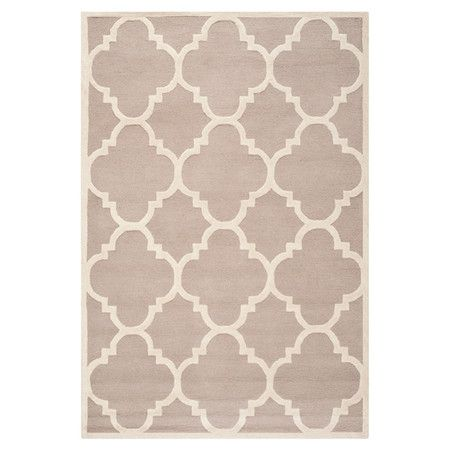 Hand-tufted wool rug with quatrefoil motif.  Product: RugConstruction Material: 100% WoolColor: ...