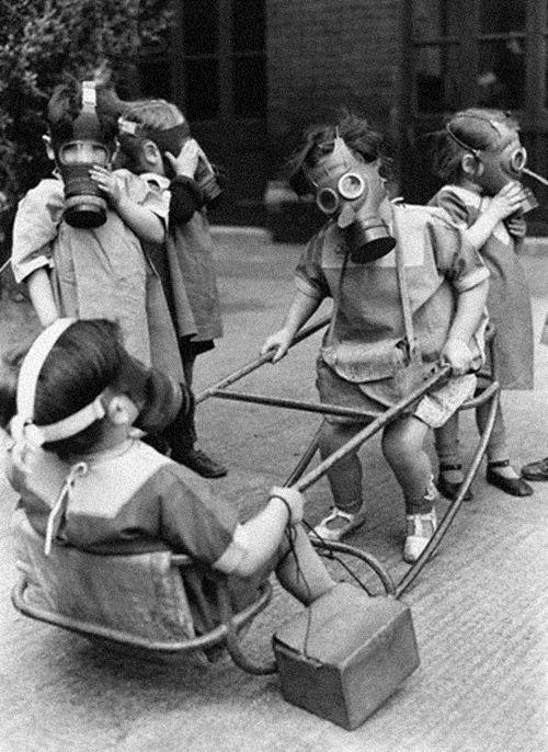 Children Play Wearing Gas Masks, 1941.   Photo:Hulton-Deutsch/corbis  ideas- the seesaw