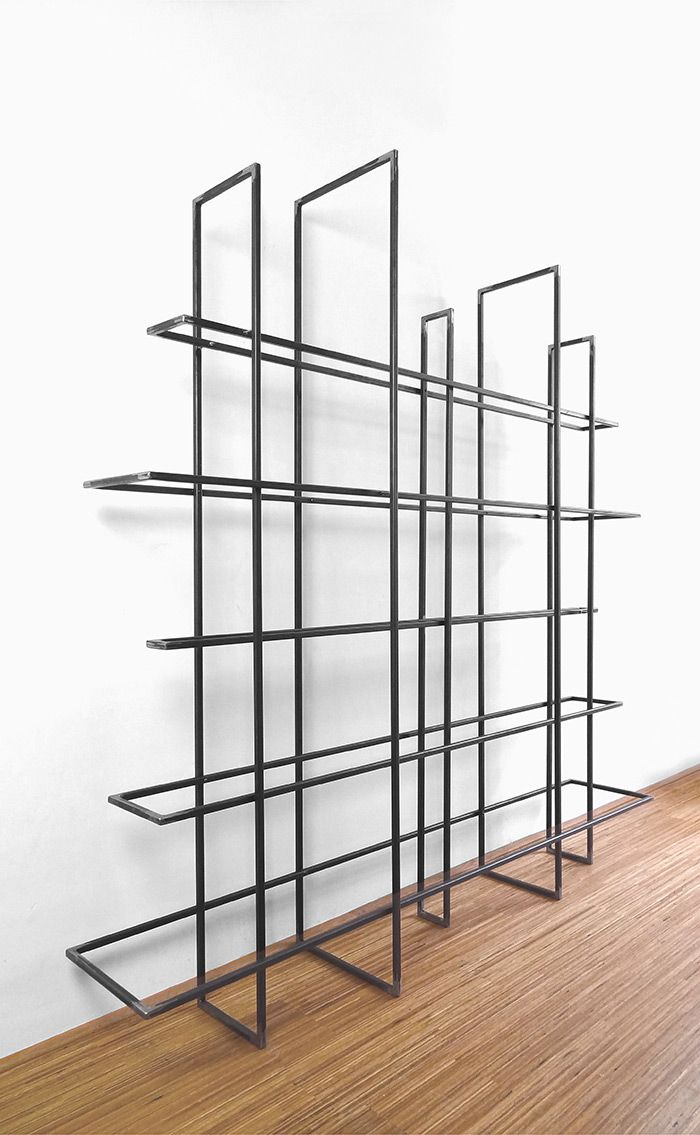 Grid, made up of 10 metal frames that as a free standing bookcase or ...
