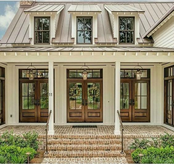 The brick, siding, and wood details make this metal roof ... on front of house awards, front of house storage, front of house signs, front of house lighting, front of house trees, front of house decor, front of house landscaping,
