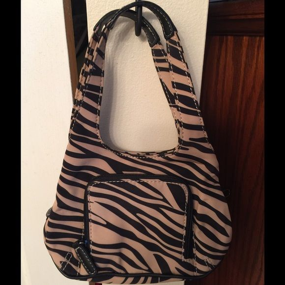 Nine West Zebra Brown & Tan Bag Nine West Zebra brown & tan bag. Has zippered compartment on front. Snaps closed at top with 2 compartments. Has inside compartment between those that Zips closed. Inside zippered compartment is a zippered pocket. Like new. Used once. Nine West Bags Mini Bags