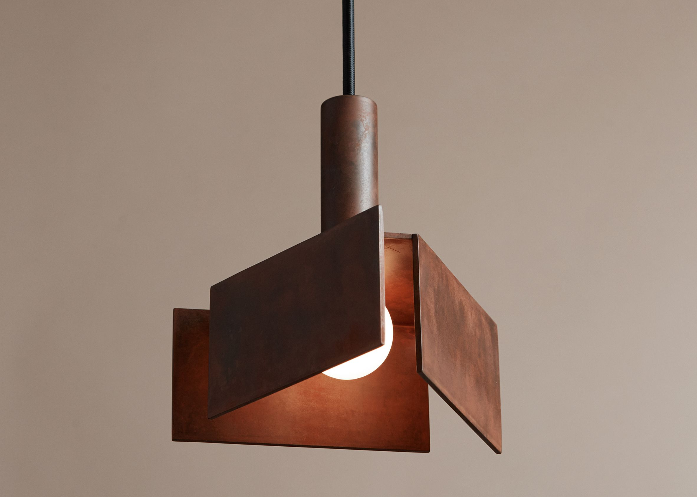 Pelle introduces geometric lighting with weathered steel fins at ids toronto