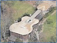 Guitar House in Fayetteville, Georgia looks like any other ranch house from the street, but from above, looks like a guitar.