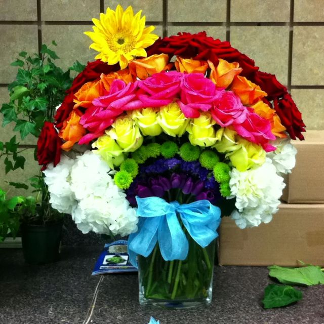 6fbde554ebac Fixed up My Saint Patrick's Day Rainbow flower arrangement with some fresh  poofier hydrangeas for the clouds.