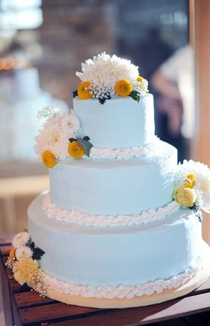 A vntage wedding cake with pretty blue and yellow details
