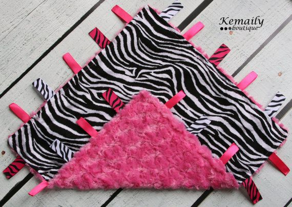 Baby Taggy  Zebra on Hot Pink Rosette Ribbon Lovey Blanket From Kemaily. $17.95, via Etsy.